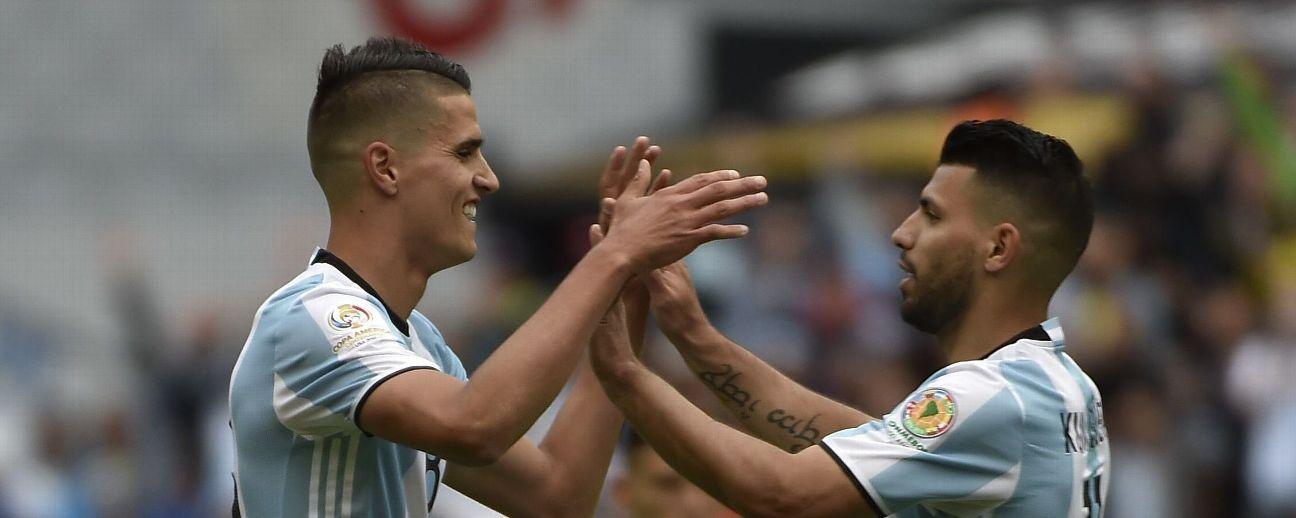 Erik Lamela and Sergio Aguero celebrate after Argentina's first goal vs. Bolivia